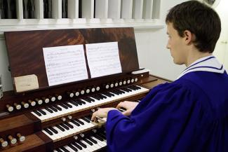 Student playing the organ