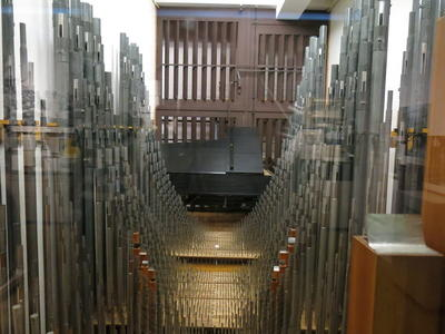 Organ pipes with grand piano in background
