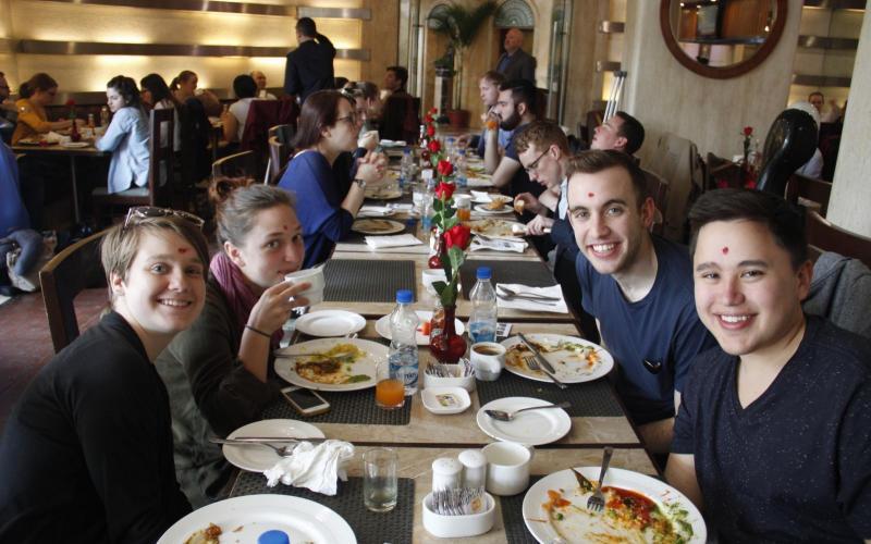 Members of Schola eating breakfast: Antonia Chandler, Addy Sterrett, James Reese, Will Doreza