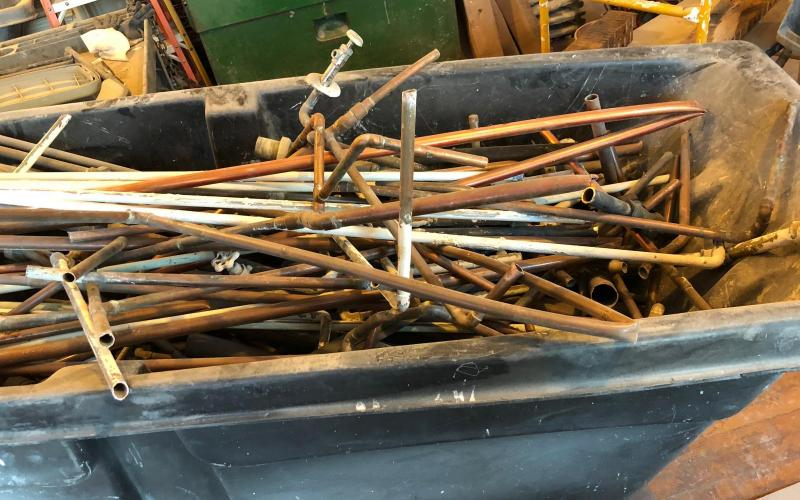 Cart full of copper pipes