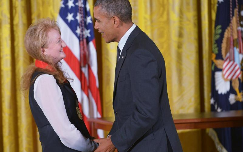 Tippett receiving National Humanities Medal from President Obama